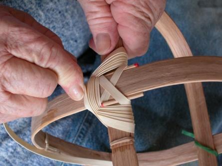 Leona Waddell making a basket