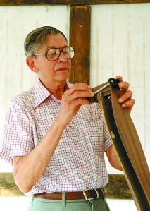 Ledford works on a dulcimer.